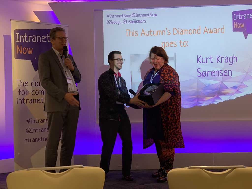 Wedge and Lisa presenting the Intranet Diamond award to Kurt